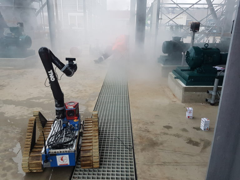 One of the UGVs was equipped with a robotic arm and was used to gather samples (on the right). We used a smoke machine during the action
